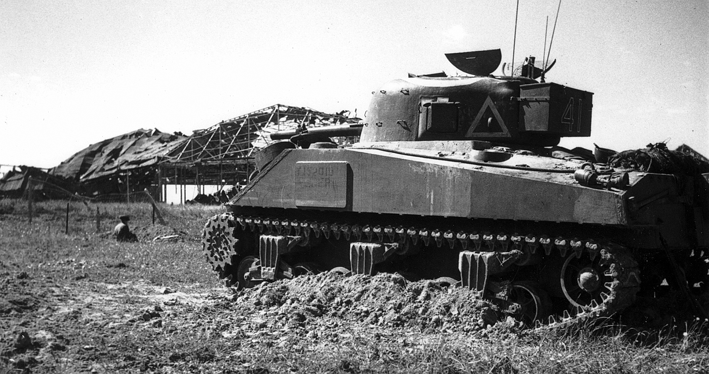 Photo of A Sherman tank at Carpiquet.
