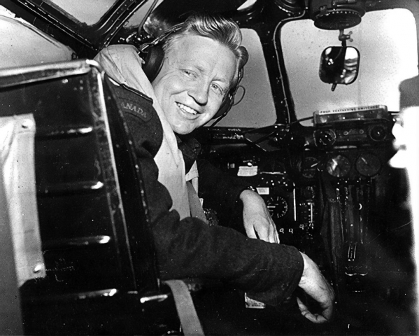 Photo of Ken Moore in his aircraft.