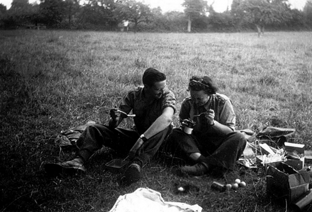 Photo of Nora picnic-ing with a friend in England before shipping over to Normandy.