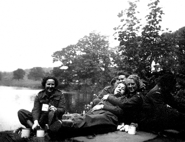 Photo of nurses relaxing by a lake.