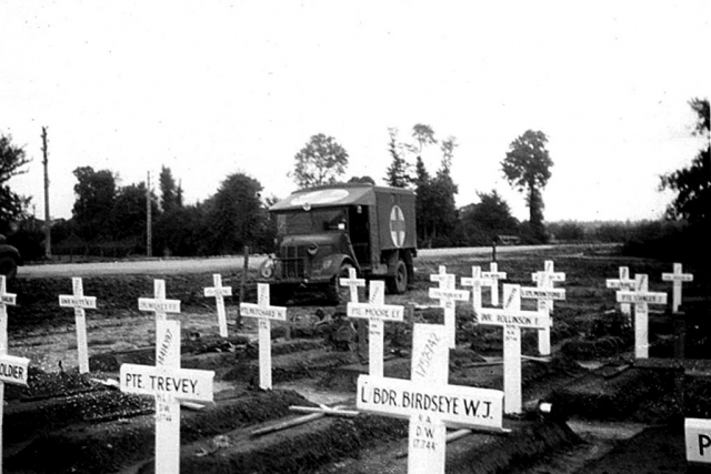 A photo of a temporary graveyard in Normandy.