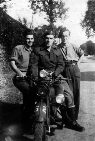 A photo of Arnott with two friends in England prior to D-Day.
