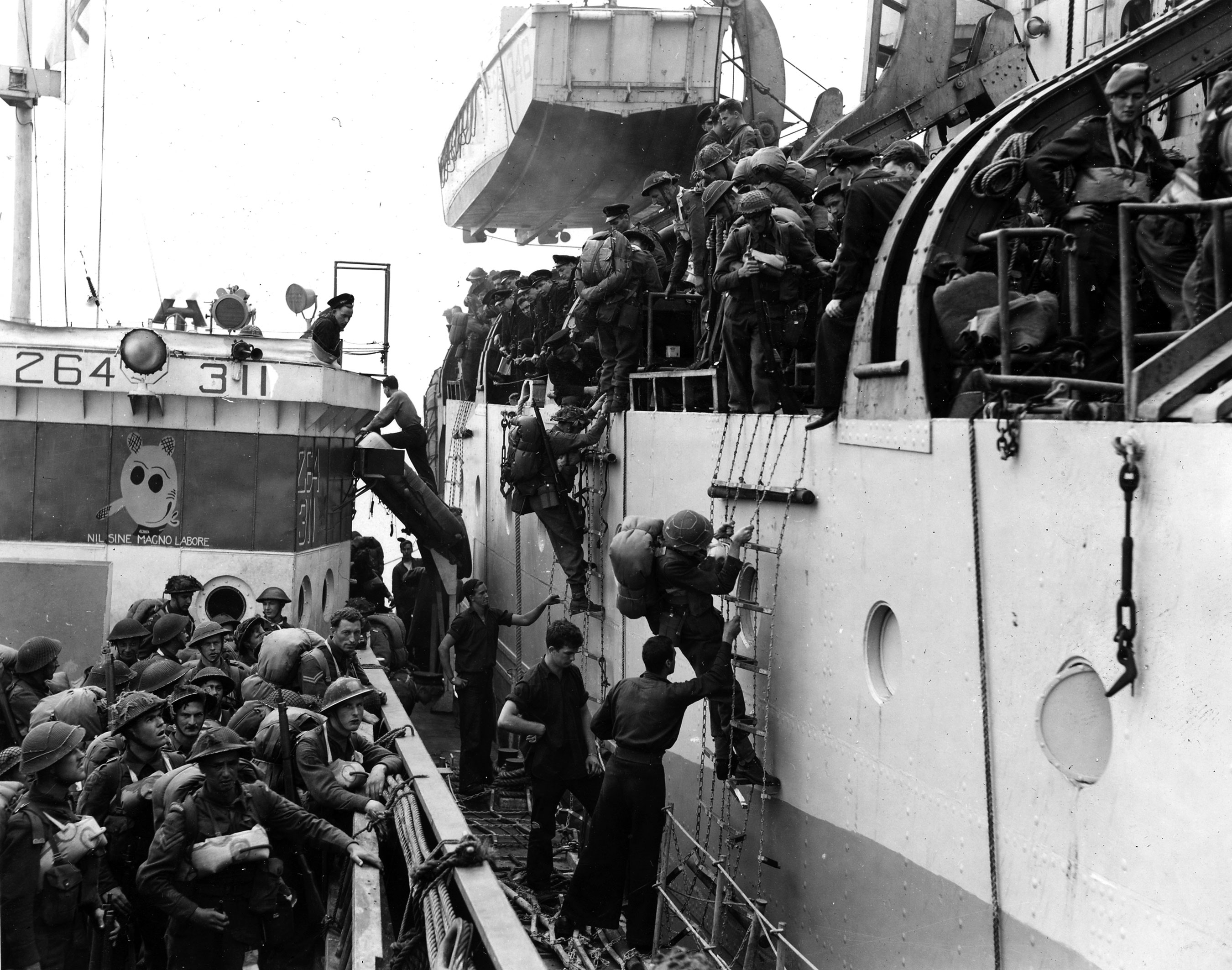 Photo of soldiers loading on to a landing craft on D-Day