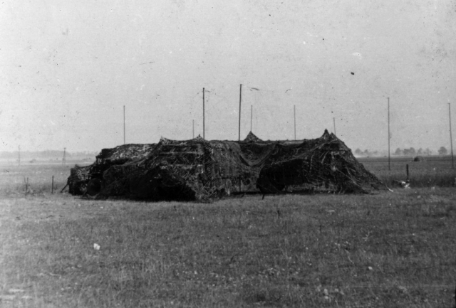 Photo of a camouflaged signals base.