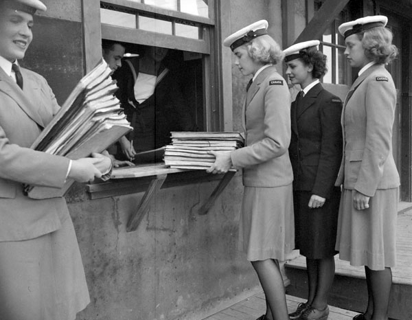 Photo of WRCNS students picking up documents.