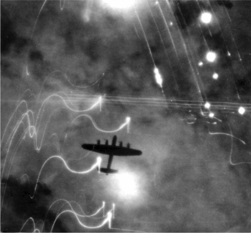 """Lancaster bomber of No 1 Group, RAF Bomber Command over Hamburg, Germany, night of 30-31 Jan 1943"" Photo: D. J. Shannon. Courtesy of the Imperial War Museum, 4700-11 C 3371."