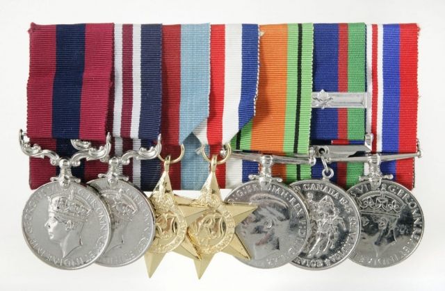Medal set belonging to Charles Henry Byce. From left to right: Distinguished Conduct Medal (DCM), Military Medal (MM), 1939-1945 Star, France & Germany Star, Defence Medal, Canadian Volunteer for Service Medal with Overseas Bar, and British War Medal (1939-1945). Found in the collection of the Canadian War Museum, 20080061-001.