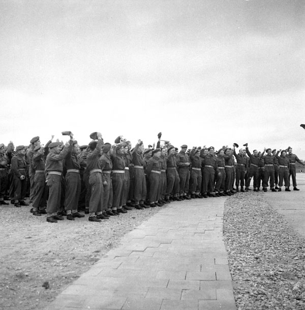 """Personnel of the 2nd Battalion, Royal Canadian Engineers (R.C.E.), cheering at the opening of the world's longest Bailey bridge, which they helped to build, Zwolle, Netherlands, 3 August 1945."" Photo: Michael M. Dean. Courtesy of Library and Archives Canada, 1967-052 NPC."
