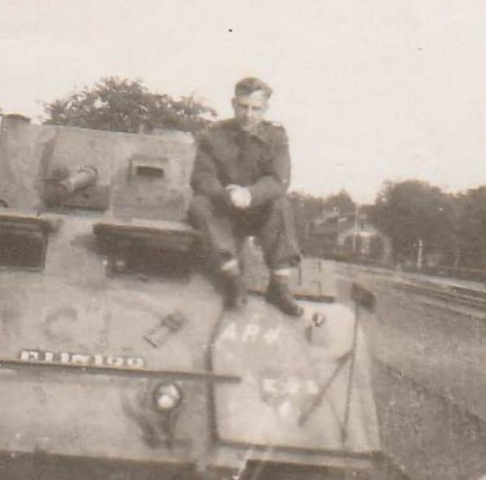 """Don White on a Staghound armoured car in Italy"" c. 1944. Courtesy of the Juno Beach Centre."