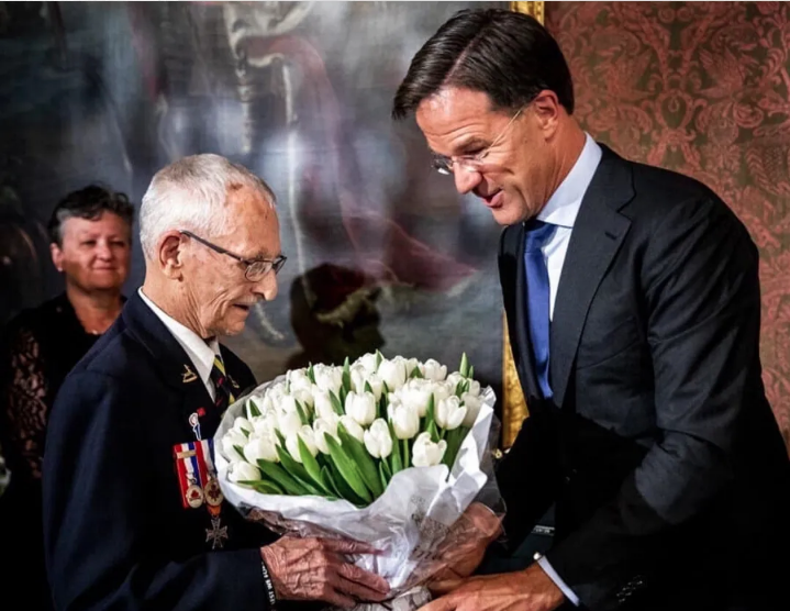 """Canadian veterans Don White receives the Don White Tulip from Dutch Prime Minister Mar Rutte, 2019"" Courtesy of the Juno Beach Centre."