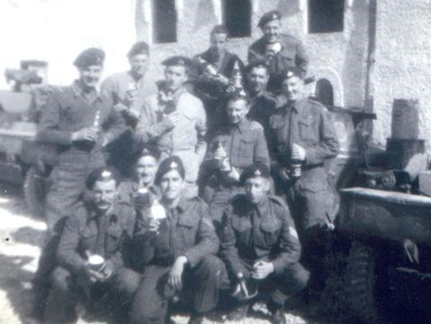 """ITALY - Second World War veteran Don White of Oshawa in Italy with his troop in April 1945. Don is in the second row, second from the right (with beer bottle on his head)."" Photo supplied to Durham Region from Don White."