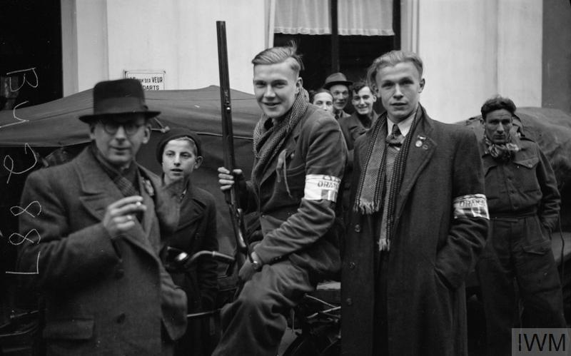 """Dutch resistance fighters (identified by their clothe armbands) in Winterswijk, after its liberation by British forces, 31 March 1945."" Photo: Sergent A. N. Midgley. Courtesy of the Imperial War Museum, BU 2887."