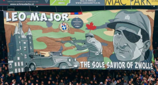 At a 2018 football game in the Netherlands, fans unveiled a banner featuring Canadian soldier Leo Major, declaring him the & sole saviour of Zwolle. Photo: FEU Zwolle/Twitter.