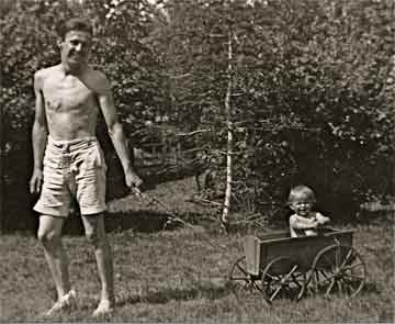 Philip Pochailo with a child from the Braals family who were members of the Dutch Resistance and who hid Philip, c. 1944.