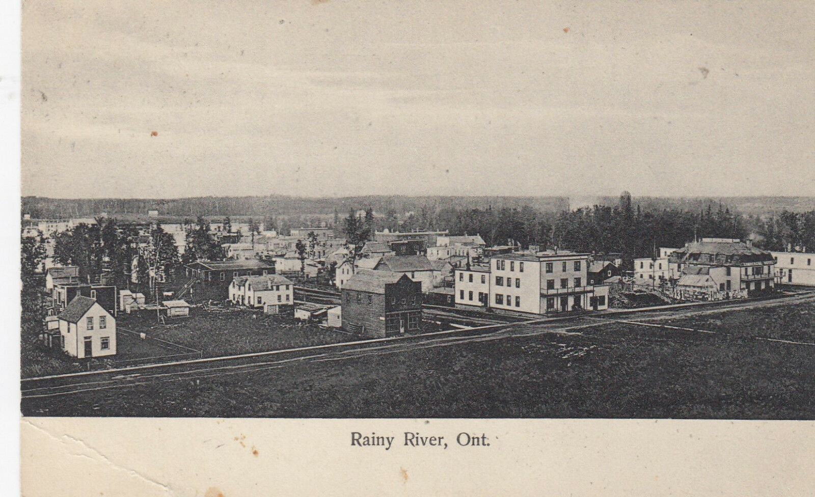 A postcard featuring an aerial view of Rainy River, Ontario (c. 1900-1910).