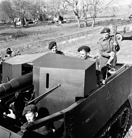 """Personnel of the Royal Canadian Dragoons in a 75mm. halftrack gun carrier near Larino, Italy, 20 March 1944."" Photo: C. E. Nye. Courtesy of Library and Archives Canada, 1967-052 NPC."