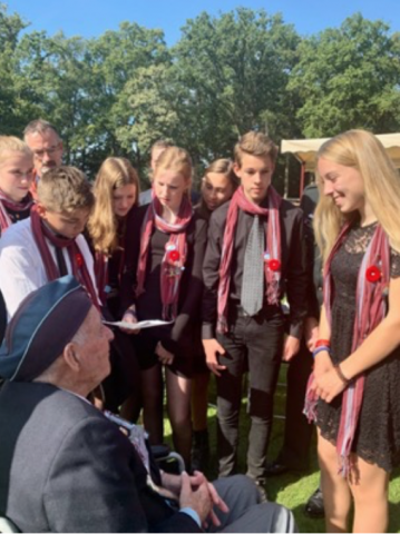 World War 2 Veteran Pilot Lloyd Bentley from Brantford, Ontario speaking with high school children at Oosterbeek War Cemetery 22 September 2019.
