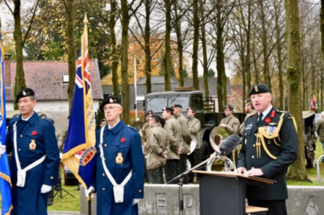 Commemoration at 'Man with Two Hats' Monument in Apeldoorn 2018. Canadian Defence Attaché, Colonel Tim Young with the Royal Canadian Legion Branch 005 (The Netherlands) Colour Party.
