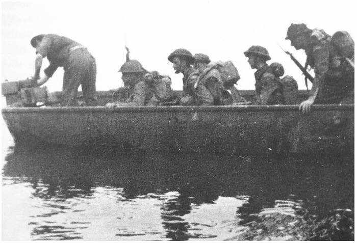 A storm boat filled with Allied soldiers about to cross the Seine River, c. 1944.