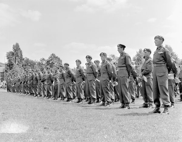 """Infantrymen of The Lake Superior Regiment (Motor) attending a memorial service for comrades who were killed in Northwest Europe. Hengelo, Netherlands, 17 June 1945."" Photo: Barney Gloster. Courtesy of Library and Archives Canada,1967-052 NPC."