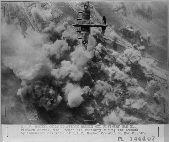 """""""A Lancaster bomber over its target."""" March 1945. Courtesy of Library and Archives Canada, RE2008-0377, Volume/box number: 364."""