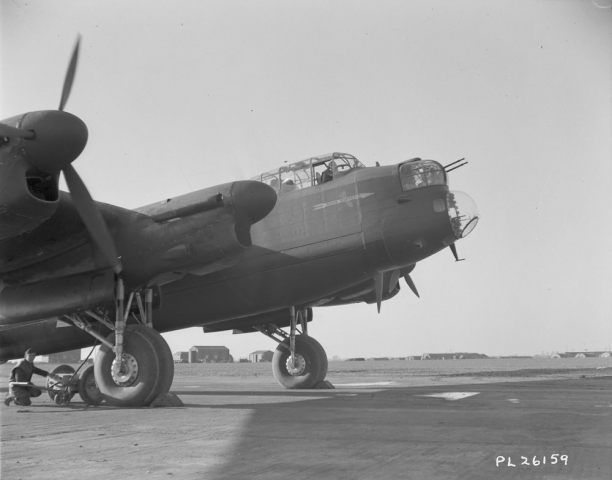 """One of the engines (second from left) on the ""Ruhr Express"" the first Canadian built Lancaster to be sent out on night bombing operations against Germany, being tested out before its first operational flight."" Courtesy of Library and Archives Canada, R112-5285-3-E. Volume/box number: 36139."