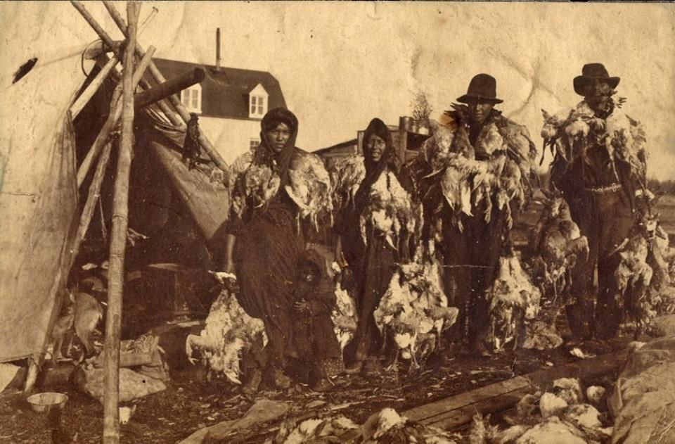 """Cree family after a successful hunting trip near Moose Factory or Moososee in Ontario - circa 1915"""